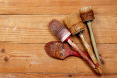 The old  brush on wooden boards Stock Photos