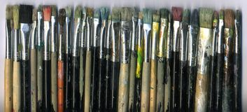 Old brushes. A set of very used painter's brushes Royalty Free Stock Photography