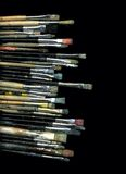 Old brushes. Many used and dirty brushes on black background Royalty Free Stock Photo