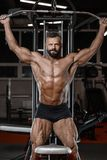 Old brutal strong bodybuilder athletic men pumping up muscles wi Royalty Free Stock Images