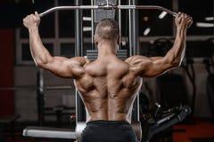 Old brutal strong bodybuilder athletic men pumping up muscles wi. Old brutal sexy strong bodybuilder athletic fitness man pumping up abs muscles workout Stock Photo