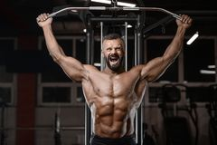 Old brutal strong bodybuilder athletic men pumping up muscles wi Stock Photos