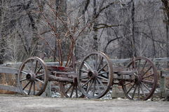 Old buckboard frame on a farm road. Royalty Free Stock Photography