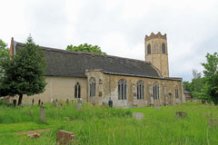 Old Buckenham Church - All Saints. The tower of the church is octagonal, from the top to the ground. In fact, it is an early 14th century casing of an earlier royalty free stock images