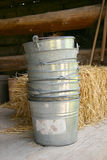 Old bucket. On a wood floor Royalty Free Stock Images