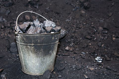 Old bucket with lumps of coal. Old bucket with lumps of black coal Royalty Free Stock Photo