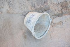 Bucket of sand pile construction site royalty free stock photos
