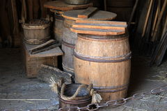 Old buckets and barrels in doorway of rustic barn Stock Image
