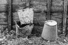 Old buckets stained in cement Royalty Free Stock Image