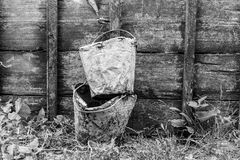 Old buckets stained in cement on a wooden background Royalty Free Stock Photography