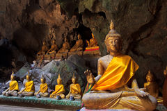 Old Buddha in a cave Stock Photography
