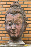 Old Buddha face statue on wall Royalty Free Stock Images