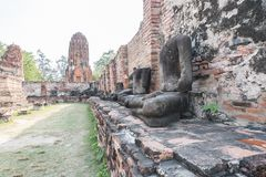 statue and ancient building at Wat Worachet Tharam temple at Ayutthaya historical park in Ayutthaya Stock Photos