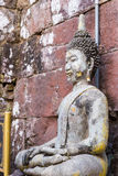 Old buddha statue in antique stone castle Stock Images