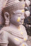 Old buddha statue in antique stone castle Stock Image