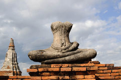 Old buddha statue and brick. The old Buddha statue and old brick wall Stock Photo