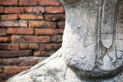 Old Buddha statue with brick wall pattern background Royalty Free Stock Photos