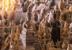 The old Buddha statue in cave at Laos Stock Photo