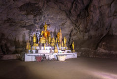 The old Buddha statue in cave at Laos Stock Image