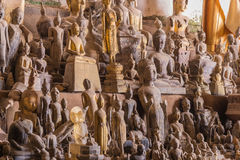 The old Buddha statue in cave at Laos Stock Photos