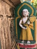 The Old Buddha statue. On the lotus with color painted Stock Photography