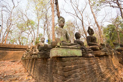 The old Buddha statue and moss at Tunnel Temple (Wat U-mong) Royalty Free Stock Photography