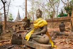 The old Buddha statue and moss at Tunnel Temple (Wat U-mong) Royalty Free Stock Images