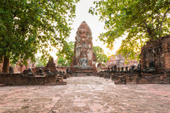 Old Buddha Statue and Old Temple Architecture Royalty Free Stock Photo