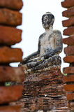 Old buddha statue and old wall with white sky Stock Photo