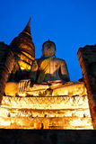 Old buddha statue and pagoda in twilight Stock Photos