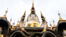 Old Buddha statue with three serpent ahead Stock Photography