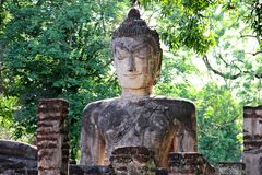 Old buddha statue wiht green leaf background at wat phra kaeo in kamphaeng phet Royalty Free Stock Photography