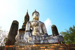 Old buddha. Old white buddha sit on remains Stock Photography