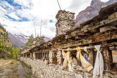 Old buddhist construction for praying wheels and Buddha images. Construction made of stones, Annapurnas, Himalayas, Nepal Royalty Free Stock Photos
