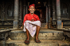 Old buddhist monk sitting in front of his temple in Kathmandu Royalty Free Stock Photography