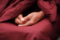Old Buddhist monk's hands