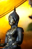 Old Buddhist statue. A black, weathered Buddhist statue or sculpture Stock Image