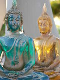 Old Buddhist statue. Green and Yellow Budhist Stock Photo