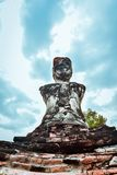 Old buddhist statue on old pagoda background stock photography