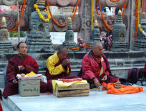 Old buddhistic monks are praying Stock Photo