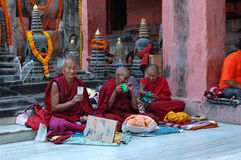 Old buddhistic monks are praying at Kagyu Monlam Stock Images