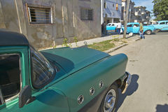 Old 1955 Buick parked with other old cars in distance of Havana, Cuba Royalty Free Stock Photos