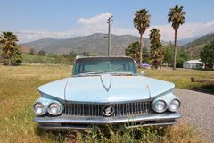 Old Buick. SPRINGVILLE, UNITED STATES - APRIL 12, 2014: 1960 Buick Invicta parked in Springville, California. The car manufacturer Buick dates back to 1903 Royalty Free Stock Images