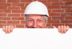 Old builder in the helmet Stock Images