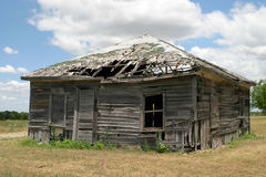 Old Building. Old rundown home being destroyed by time and weather, but still standing Royalty Free Stock Photos