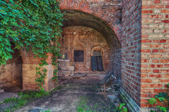 Old building. Old abandoned building with an arch with ivy Royalty Free Stock Images