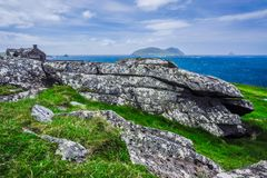 Old Building along the Rocky Coast. A crumbling old structure deteriorates on a rocky hillside above the Atlantic Ocean on the Dingle Peninsula, Ireland Stock Photos