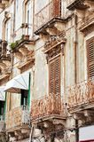 Old building with balconies Stock Photos