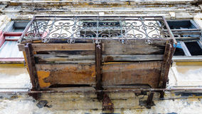 Old building balcony deprecated facade texture Royalty Free Stock Images