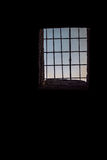 Old building black dark walls with window and rusty bars, vertical background Stock Photography